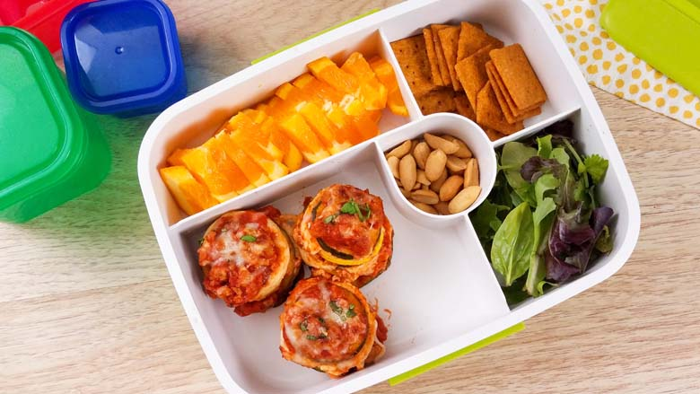 lasagna stacks and fruit in a to go container
