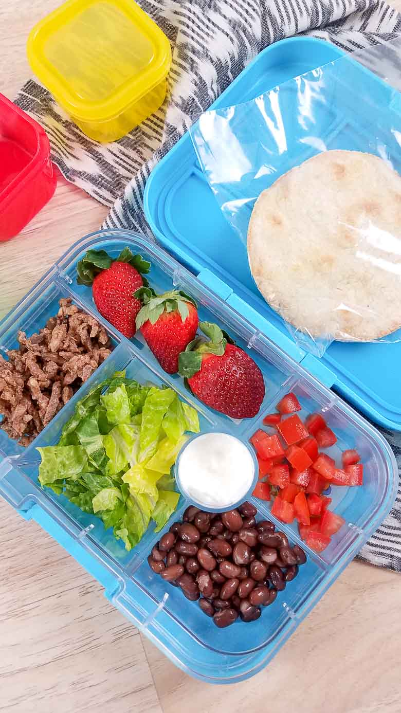 carne asada tostadas in a blue meal prep container