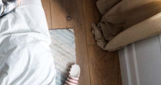 image of slippers next to a bed