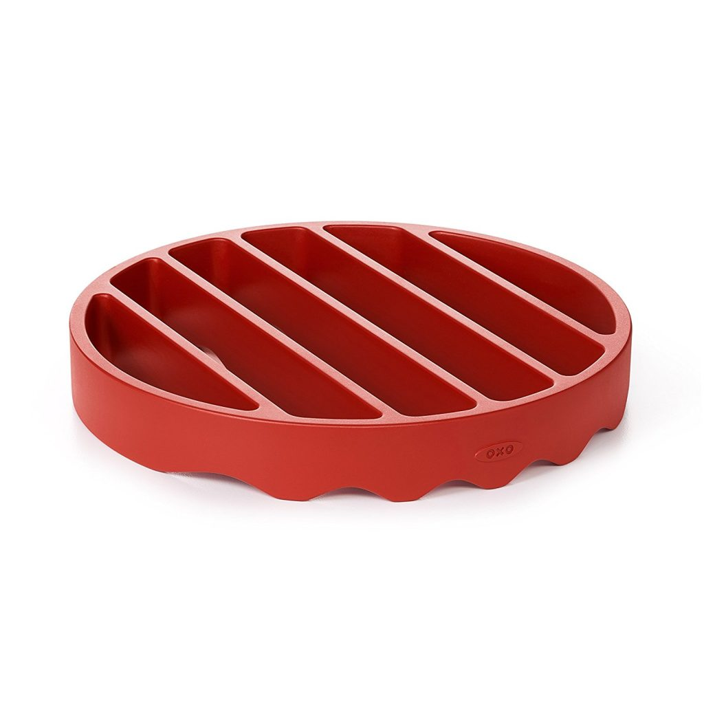 silicone trivet in red.