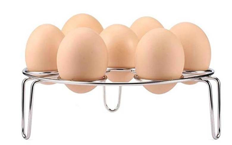 metal egg rack with eggs in it.