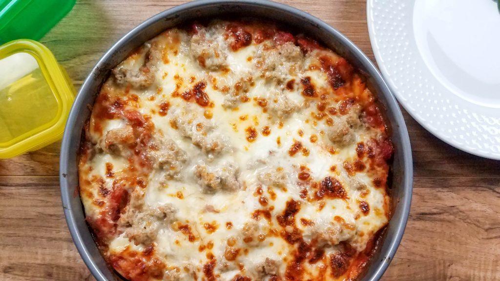 springform pan with lasagna baked inside.