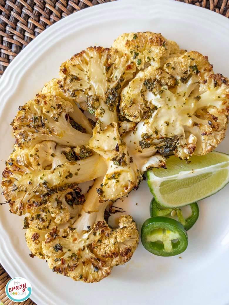 image of single cauliflower steak on a white plate