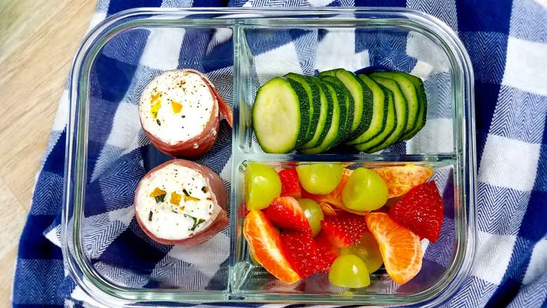 egg white bites with fruit and veggies in to go container