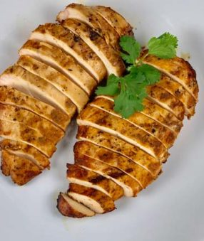 chipotle chicken sliced on white plate