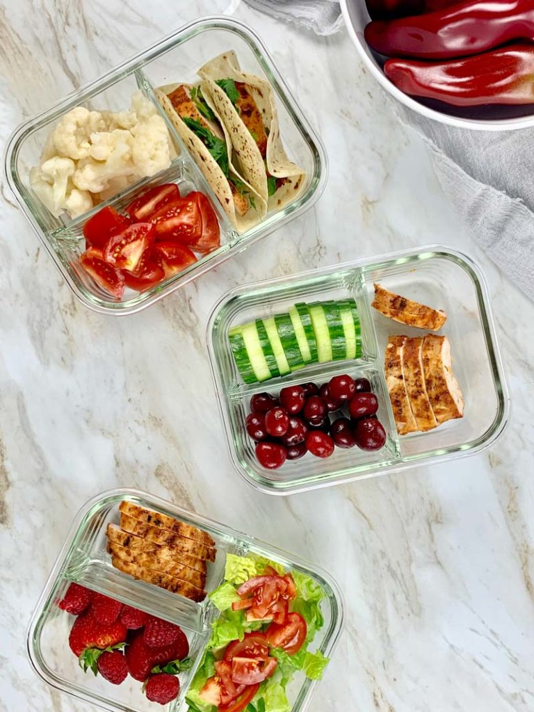 three meal prep containers with chipotle chicken recipes