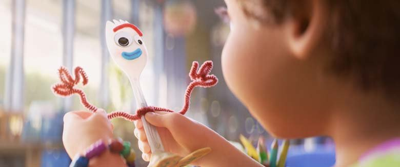 image of Forky character bring held by girl