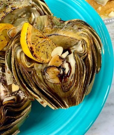 roasted artichokes on turquoise plate