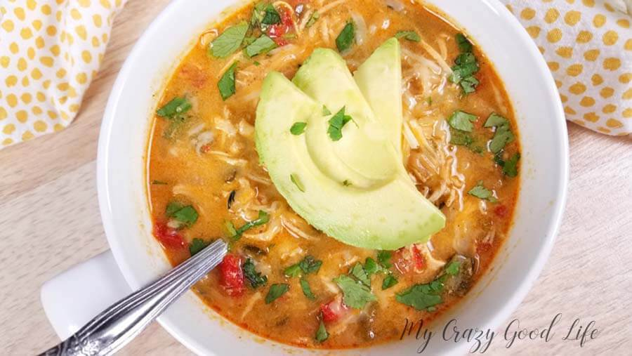 White chicken chili with avocado on top.