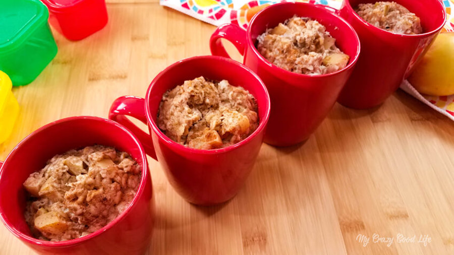 Finished apple cinnamon oatmeal cups in red mugs