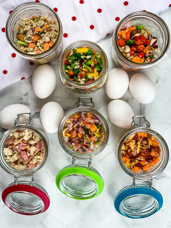 eggs on counter with mason jars full of healthy ingredients