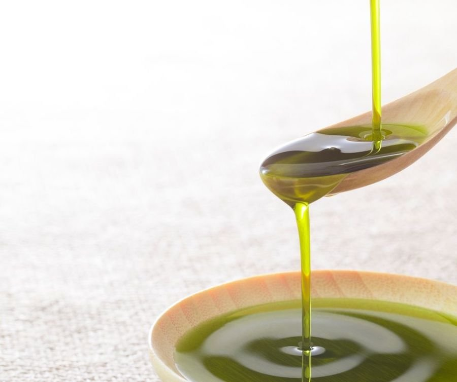 Extra virgin olive oil on a spoon