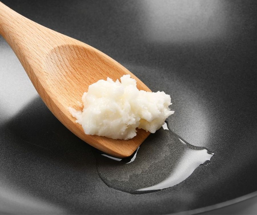 coconut oil in a pan being used for cooking.