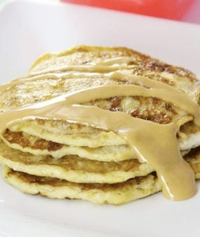 banana pancakes shown with peanut butter topping.