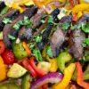 close up of mushrooms and other fajita vegetables