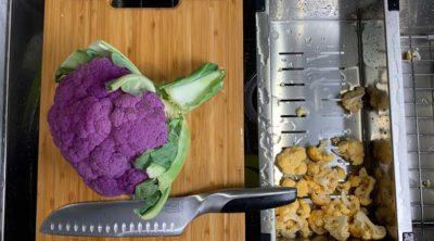 purple cauliflower on wood cutting board