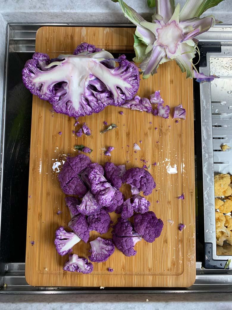 cut cauliflower on a cutting board