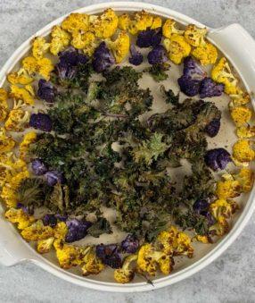 roasted cauliflower and kale on stone