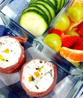 starbucks egg white bites in a meal prep container with fruit and veggies