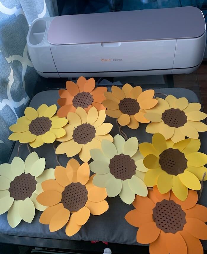 Cricut Maker in the background of the finished sunflowers sag