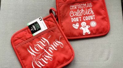 image of red potholders with Christmas phrases