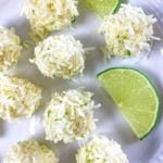 white plate with coconut bites and lime slices