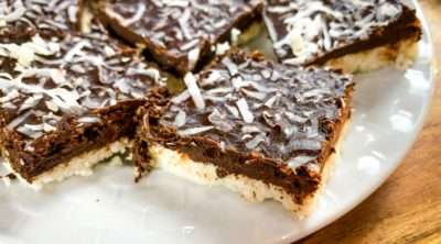 close up if coconut bars on white plate