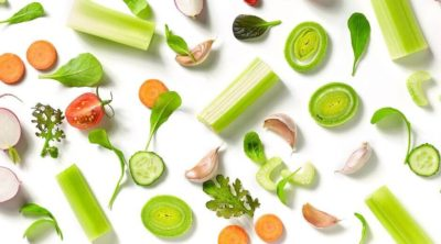 featured image for high fiber vegetables post with vegetables laid out on white backdrop.