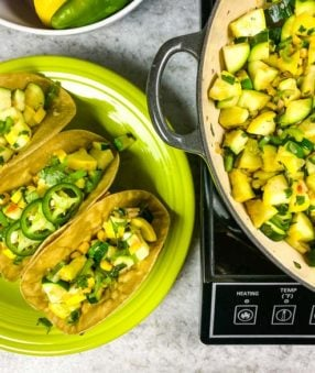 calabacitas and tacos on a green plate