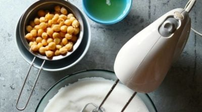 Image shows what is aquafaba and how to whip it for desserts.