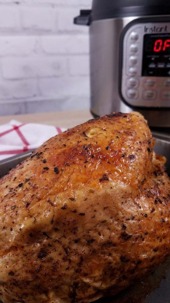 close up of cooked turkey breast in roasting pan