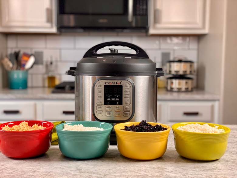 image of Instant Pot on counter with four bowls of different rice in front