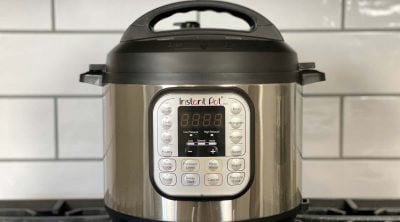 instant pot sitting on top of stove top