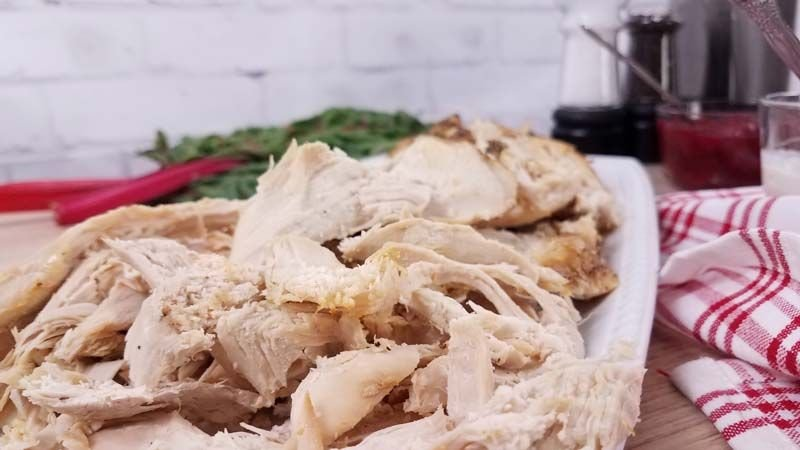 cooked carved turkey on white plate