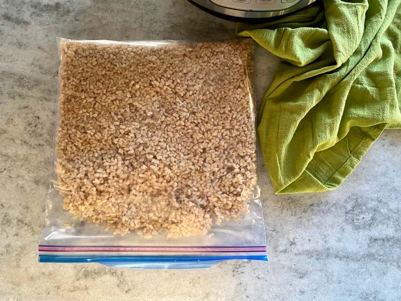 brown rice in a freezer bag on counter with green towel