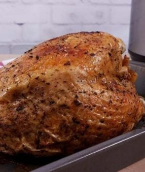 cooked turkey breast in roasting pan