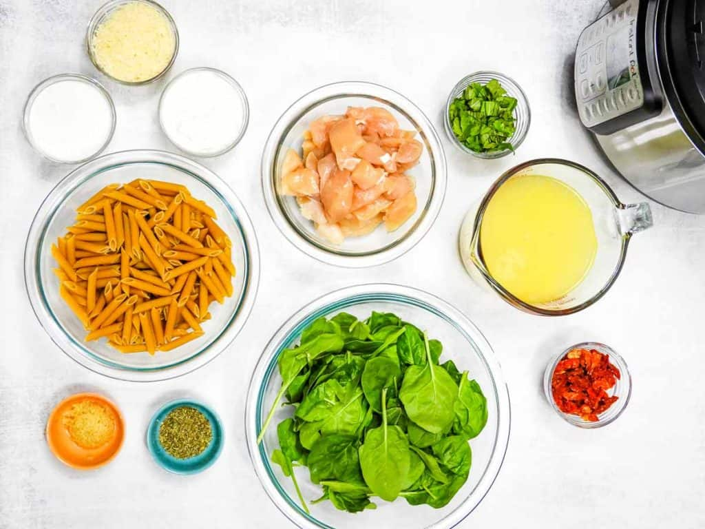 top down view of ingredients in tuscan chicken pasta