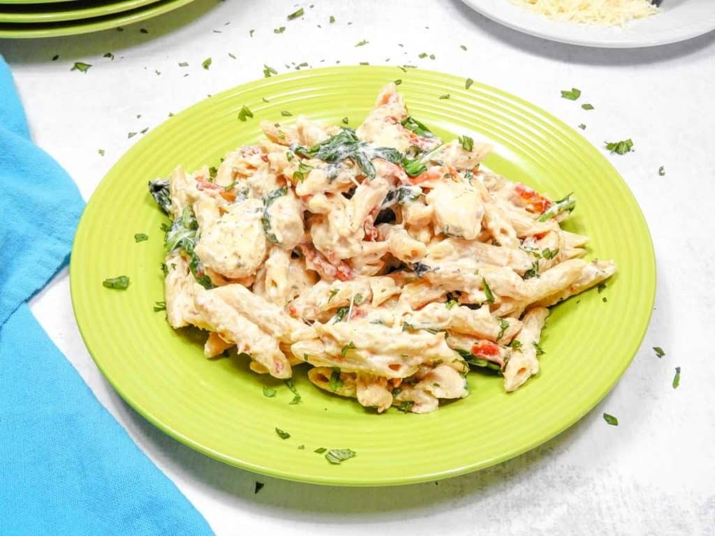tuscan chicken pasta on green plate