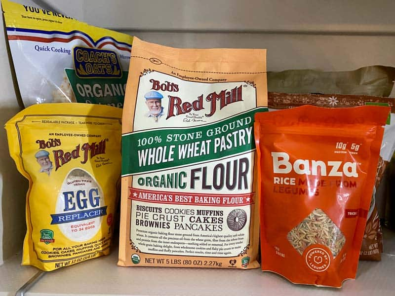 healthy pantry items: wheat flour, chickpea pasta, egg replacer
