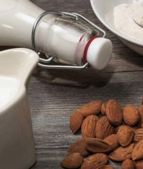 almonds and almond milk containing gellan gum, on table