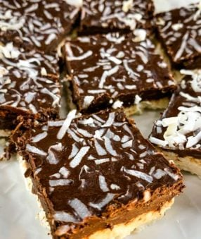 mocha coconut bars on a white plate