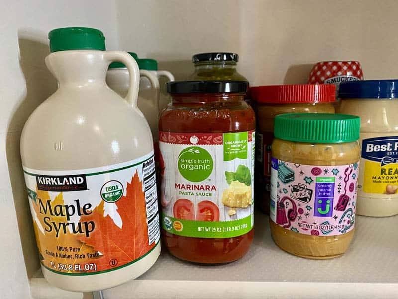 pantry items syrup, nut butters, and pasta sauce