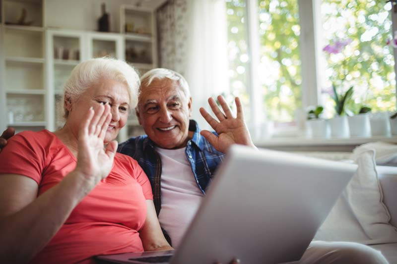 grandparents waving to the computer