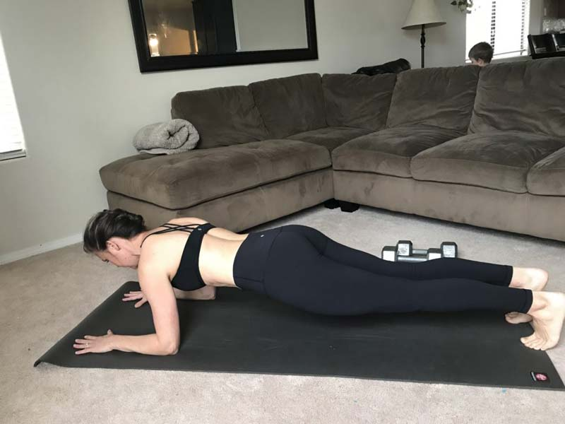 image of girl performing plank on elbows