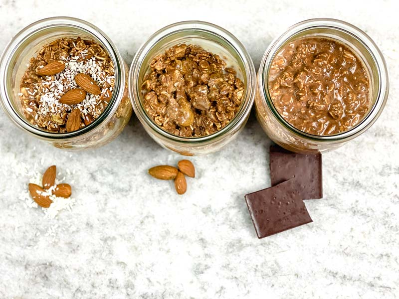 three glass jars of chocolate oats