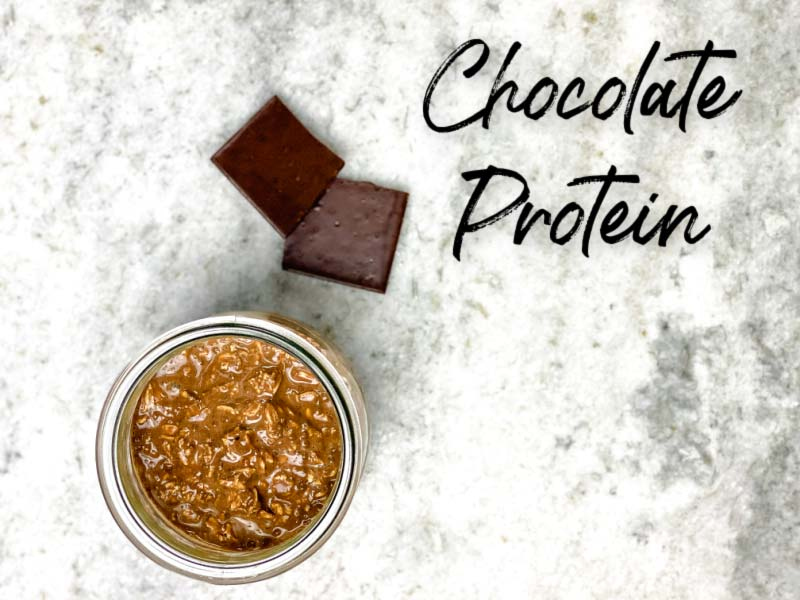 close up of chocolate protein overnight oats and chocolate