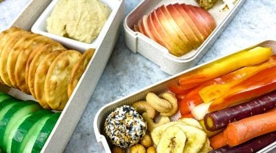 close up of vegetables and snacks in a charcuterie lunch box