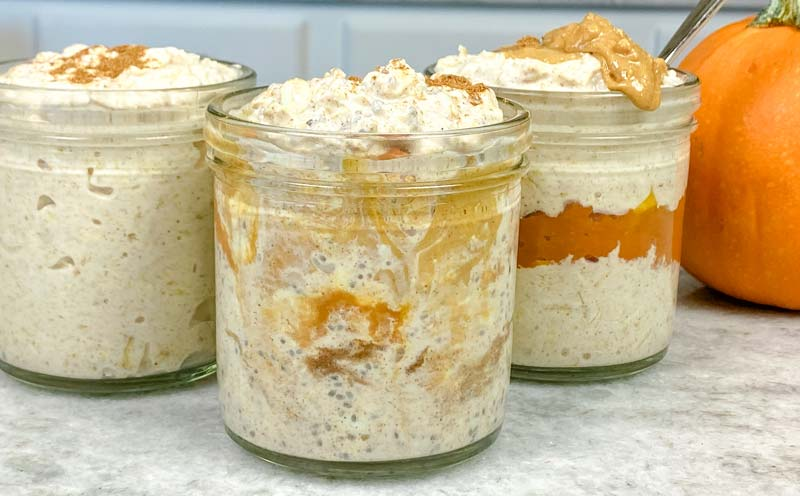 three jars of pumpkin overnight oats on counter
