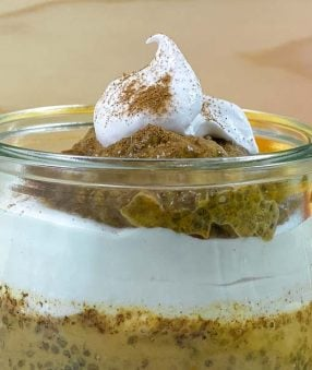 close up of coconut whipped cream on chia pudding