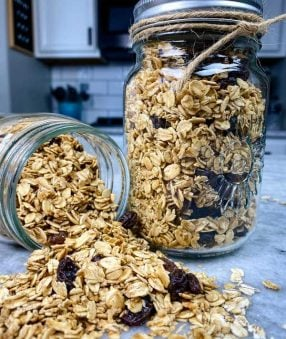 canning jar spilliing out healthy homemade granola